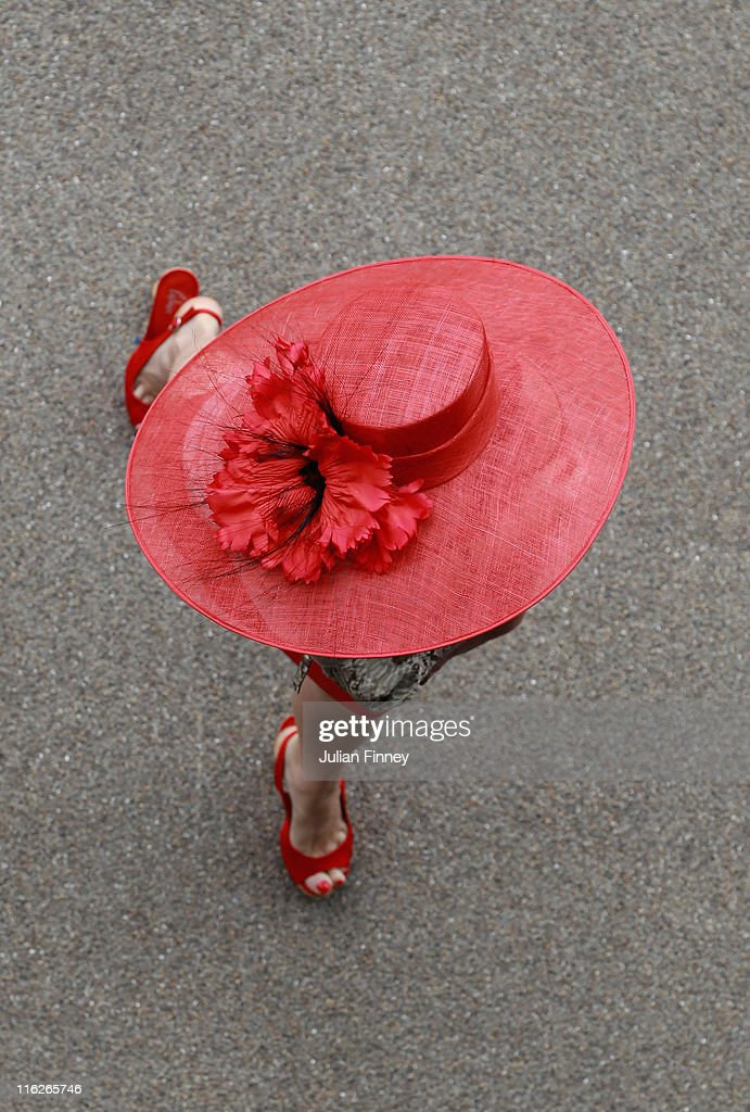 Racegoers arrive during day two of Royal Ascot at Ascot racecourse on June 15, 2011 in Ascot, England.
