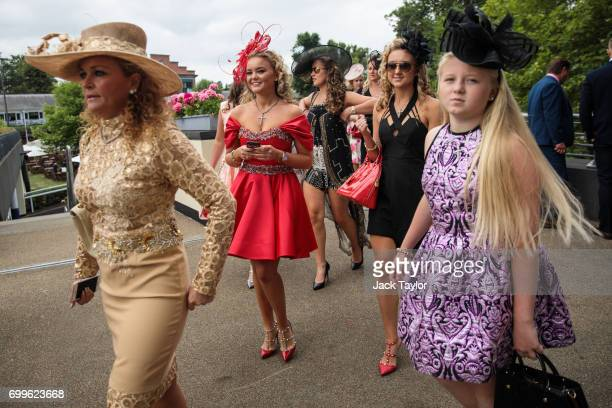 Racegoers arrive on day 3 of Royal Ascot at Ascot Racecourse on June 22 2017 in Ascot England The fiveday Royal Ascot meeting is one of the...
