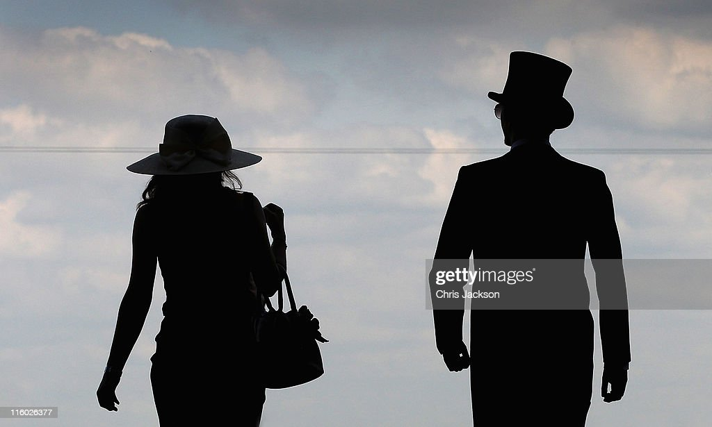 Racegoers arrive on the opening day of Royal Ascot at Ascot Racecourse on June 14, 2011 in Ascot, United Kingdom.
