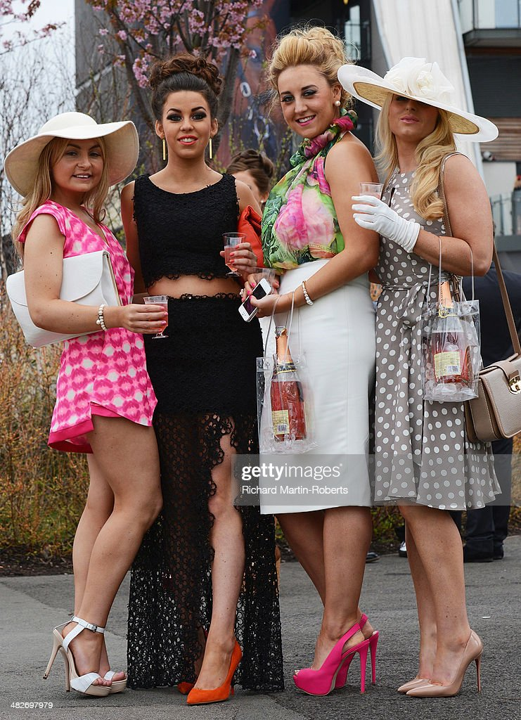 Racegoers attend Day 2, Ladies Day, of the Aintree races at Aintree Racecourse on April 4, 2014 in Liverpool, England.