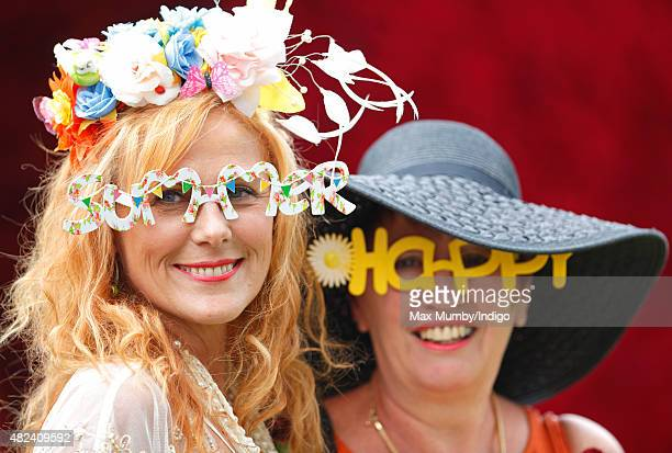 Racegoers attend day three of the Qatar Goodwood Festival at Goodwood Racecourse on July 30 2015 in Chichester England