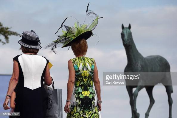 Racegoers attend Ladies Day at Goodwood Races on July 31 2014 in Chichester England Today is Ladies Day at the prestigious Goodwood Races