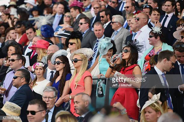 Racegoers attend Ladies Day at Royal Ascot Racecourse on June 18 2015 in Ascot England The Royal Ascot horse race meeting runs from June 16 until...