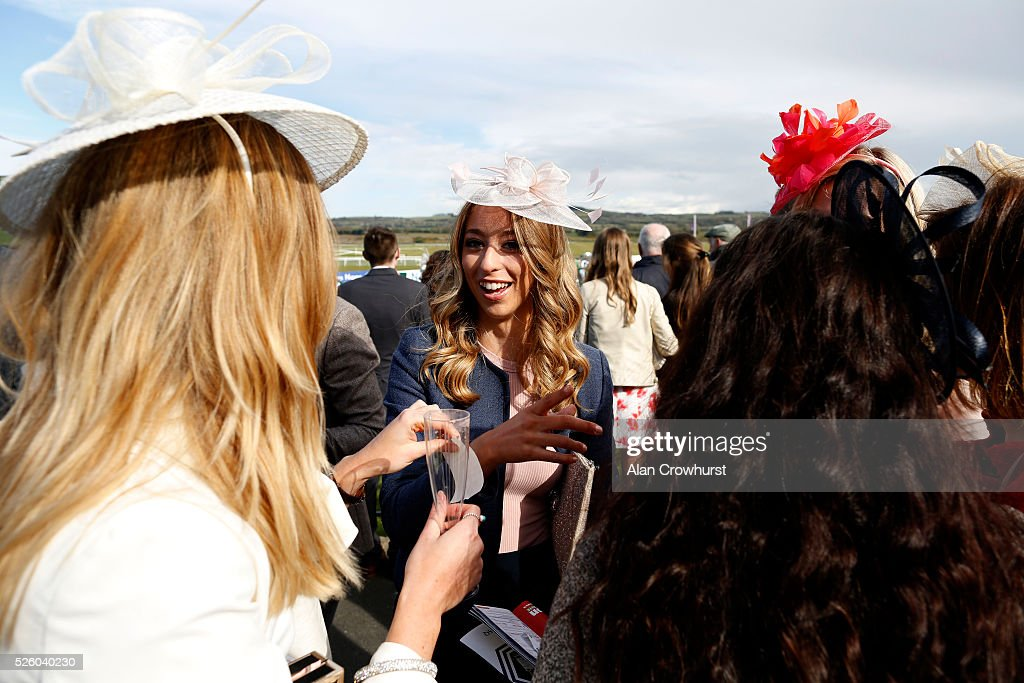 Racegoers attend Punchestown racecourse on April 29, 2016 in Naas, Ireland.