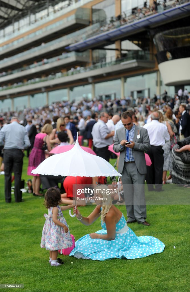 Racegoers attend the Betfair Weekend King George Day and Summer Garden Party at Ascot Racecourse on July 27, 2013 in Ascot, England.