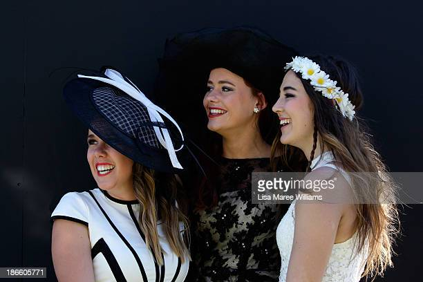 Racegoers attend Victoria Derby Day at Flemington Racecourse on November 2 2013 in Melbourne Australia