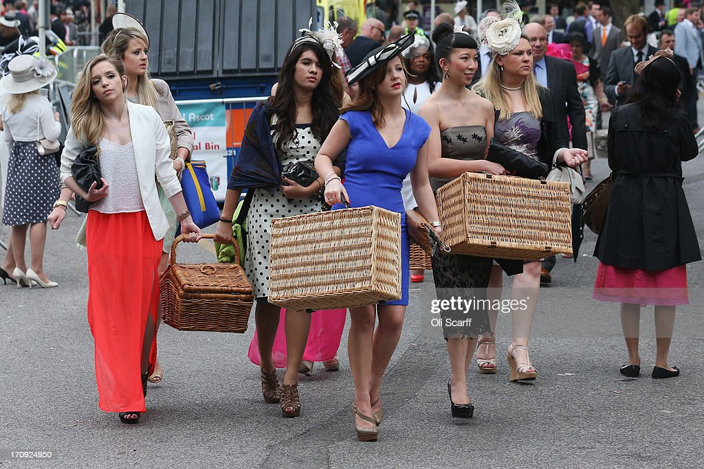 Racegoers carry hampers to Ascot racecourse to attend Royal Ascot on June 20, 2013 in Ascot, England. The 'Royal Ascot' horse race meeting runs from June 18, 2013 until June 22, 2013 and has taken place since 1711. The racecourse is expected to welcome around 280,000 racegoers over the five days, including Her Majesty The Queen and other members of the Royal Family.
