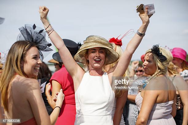 Racegoers celebrating after winning a bet on a race on Ladies Day of Royal Ascot at Ascot racecourse in Berkshire England on June 18 2015 The 5 day...