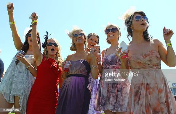 Racegoers cheer as they watch a race during the Caulfield Guineas Day at Caulfield Racecourse on October 9 2010 in Melbourne Australia