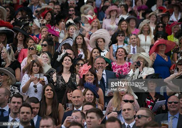 Racegoers cheer on the race horses during Ladies Day at the Royal Ascot Racecourse on June 19 2014 in London England The Royal Ascot horse race...