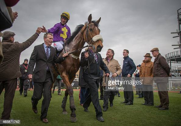 Racegoers congratulate Windsor Park ridden by Davy Russell after he won the first race on the second day of the Cheltenham Festival on March 11 2015...