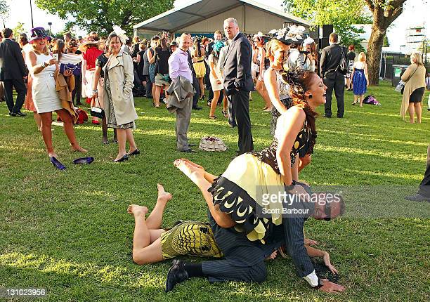 Racegoers dance as a band palys music after Melbourne Cup Day at Flemington Racecourse on November 1 2011 in Melbourne Australia