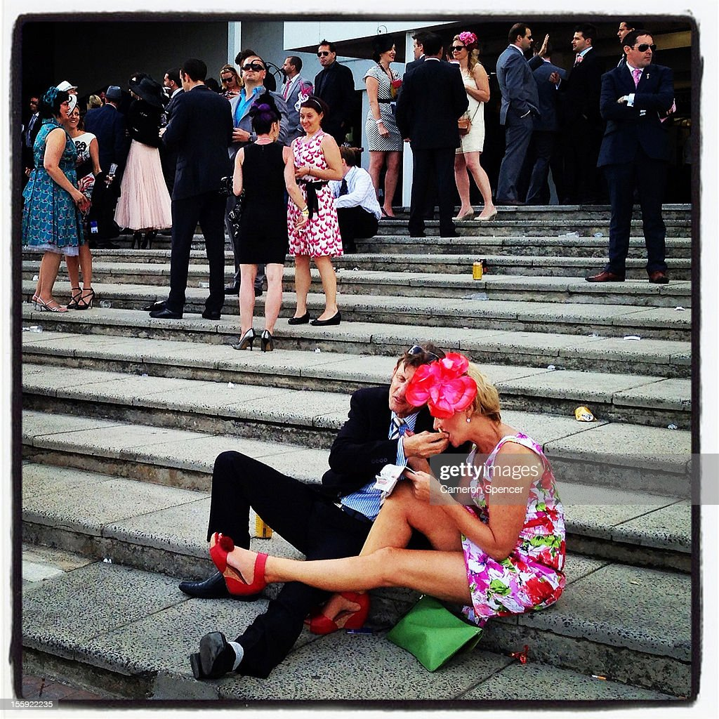 A Racegoers eat following racing during Crown Oaks Day at Flemington Racecourse on November 8, 2012 in Melbourne, Australia.