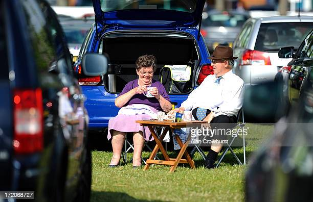 Racegoers enjoy a cup of tea in the car park before racing at Windsor racecourse on July 01 2013 in Windsor England