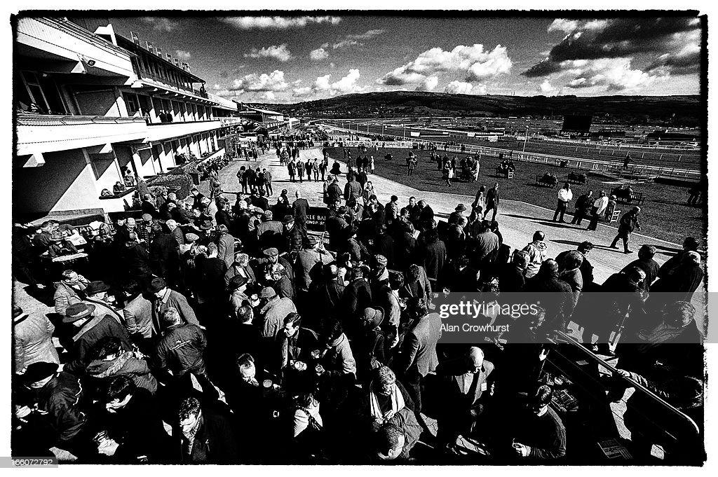 Racegoers enjoy a drink during St Patrick's Thursday at Cheltenham racecourse on March 14, 2013 in Cheltenham, England.