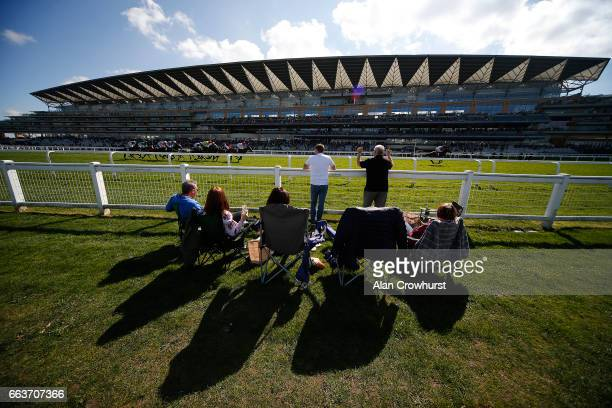 Racegoers enjoy a picnic as the runners pass at Ascot Racecourse on April 2 2017 in Ascot England