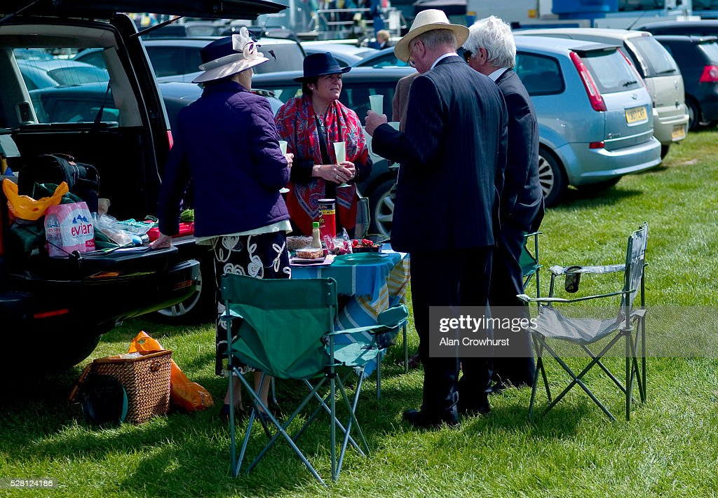 Racegoers enjoy a picnic before racing at Chester racecourse on May 4, 2016 in Chester, England.