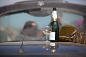 Racegoers enjoy a picnic lunch in the car park at Cheltenham Racecourse on the first day of the Cheltenham Festival on March 10 2015 in Cheltenham...