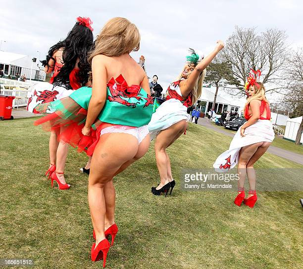 Racegoers enjoy Ladies Day at Aintree on April 5 2013 in Liverpool England Friday is traditionally Ladies day at the threeday meeting of the world...