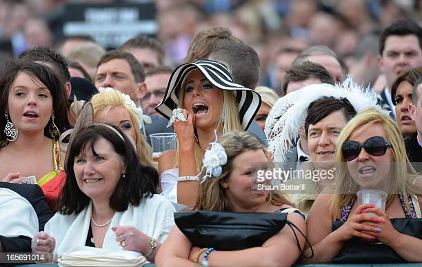 Racegoers enjoy Ladies' Day at Aintree Racecourse on April 5 2013 in Liverpool England