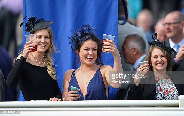 Racegoers enjoy Ladies Day prior to the Alder Hey Children's Charity Handicap Hurdle at Aintree Racecourse on April 8 2016 in Liverpool England