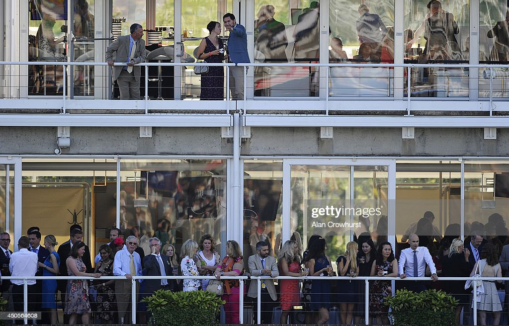 Racegoers enjoy some hospitality at Goodwood racecourse on June 13, 2014 in Chichester, England.