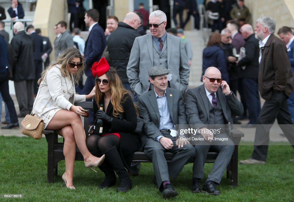Racegoers enjoy the atmosphere during Champion Day of the 2017 Cheltenham Festival at Cheltenham Racecourse.