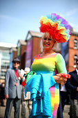 Racegoers enjoy the atmosphere during Ladies Day at Aintree Racecourse on April 10 2015 in Liverpool England