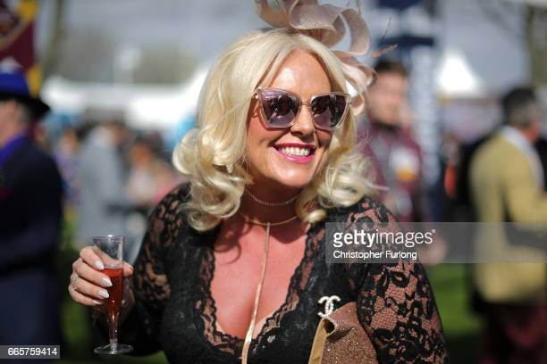 Racegoers enjoy the atmosphere of Ladies Day at the Randox Health Grand National Festival at Aintree Racecourse on April 7 2017 in Liverpool England...