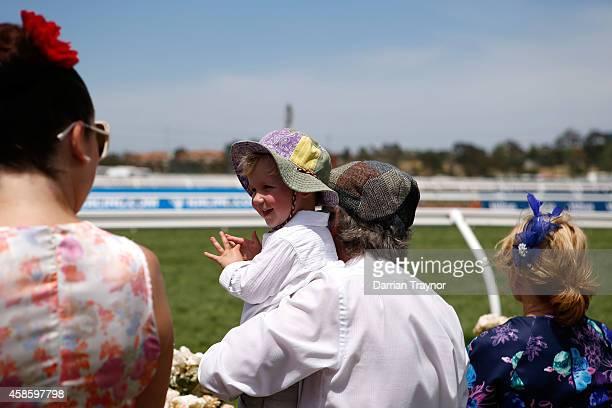 Racegoers enjoy the atmosphere on Stakes Day at Flemington Racecourse on November 8 2014 in Melbourne Australia