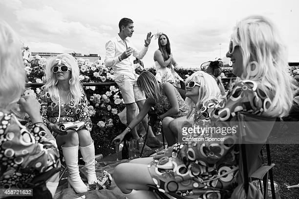 Racegoers enjoy the atmosphere on the public lawn on Melbourne Cup Day at Flemington Racecourse on November 4 2014 in Melbourne Australia