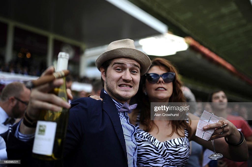 Racegoers enjoy the day at Longchamp racecourse on October 06, 2013 in Paris, France.