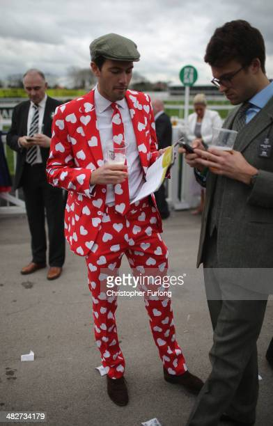 Racegoers enjoy the party atmosphere of Ladies Day and dress to impress at the Aintree Grand National Festival meeting on April 4 2014 in Aintree...