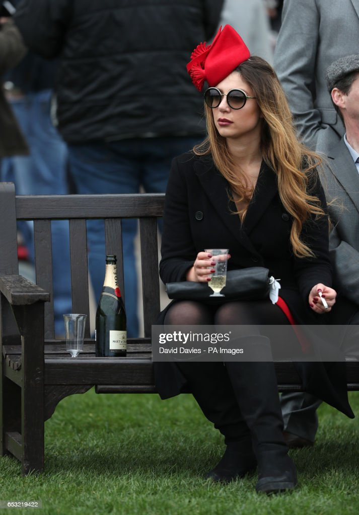 A racegoers enjoys the atmosphere during Champion Day of the 2017 Cheltenham Festival at Cheltenham Racecourse.