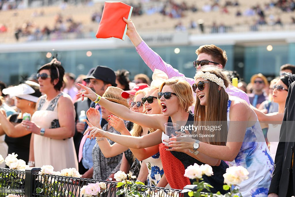 Racegoers enjoys the atmosphere on Crown Oaks Day at Flemington Racecourse on November 8, 2012 in Melbourne, Australia.