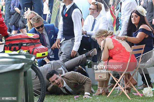 Racegoers fall over following 2016 Melbourne Cup Day at Flemington Racecourse on November 1 2016 in Melbourne Australia