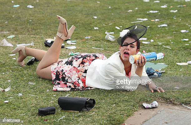 A racegoers falls over following 2016 Melbourne Cup Day at Flemington Racecourse on November 1 2016 in Melbourne Australia
