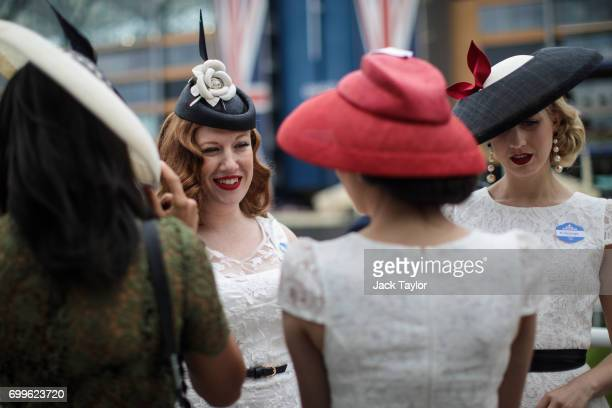 Racegoers gather on day 3 of Royal Ascot at Ascot Racecourse on June 22 2017 in Ascot England The fiveday Royal Ascot meeting is one of the...