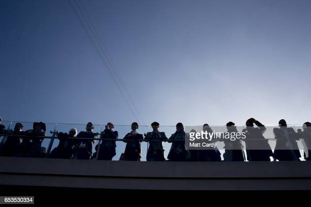 Racegoers gather to study the horses at the Cheltenham Racecourse on Ladies Day the second day of the Cheltenham Festival on March 15 2017 in...