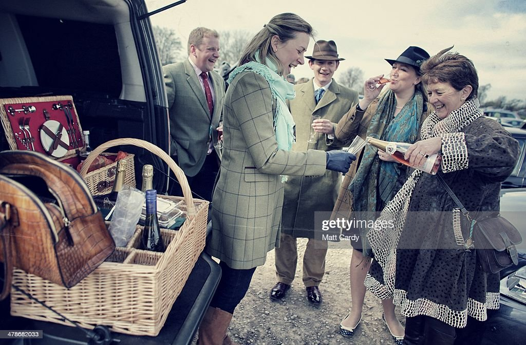 Racegoers have a picnic in the car park on the first day of the Cheltenham Festival on March 11, 2014 in Cheltenham, England. Thousands of racing enthusiasts are expected at the four-day festival, which starts today with the festival's Champion Day and is seen as many as the highlight of the jump racing calendar.