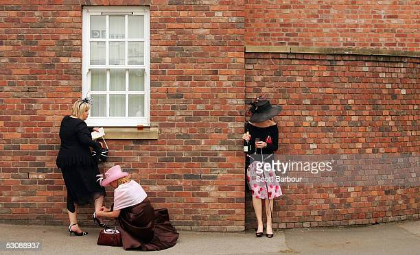 Racegoers having a good time make their way home after attending the third day Ladies Day of Royal Ascot 2005 at York Racecourse on June 16 2005 in...