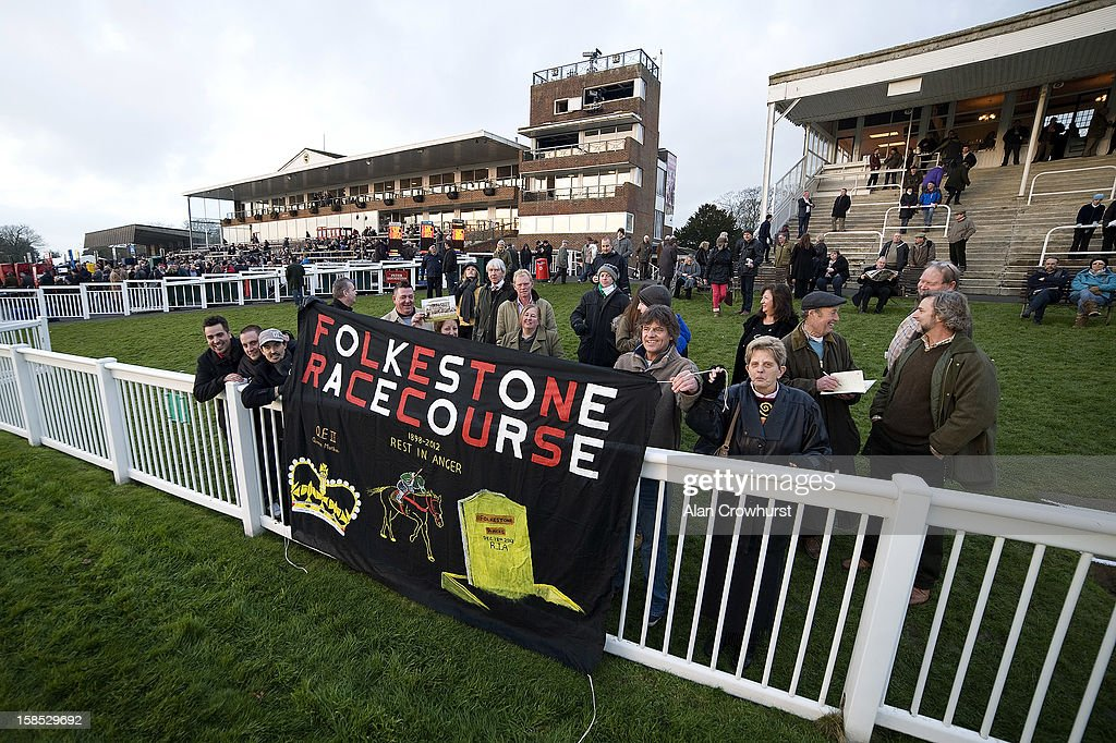 Racegoers hold up a banner during the last meeting to be held after 114 years of racing at Folkestone racecourse on December 18, 2012 in Folkestone, England.