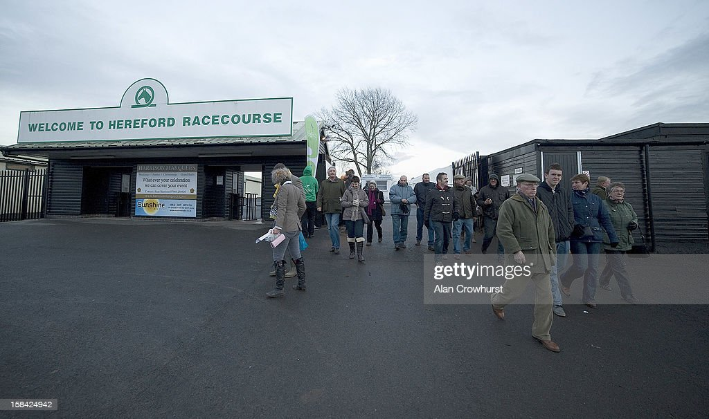 Racegoers leave after the last race during the last meeting to be held at Hereford racecourse after 241 years of racing on December 16, 2012 in Hereford, England.