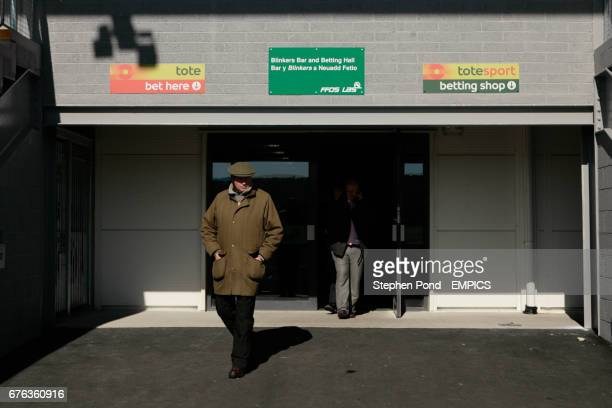 Racegoers leave the tote bookmakers in the Blinkers bar and betting hall at Ffos Las