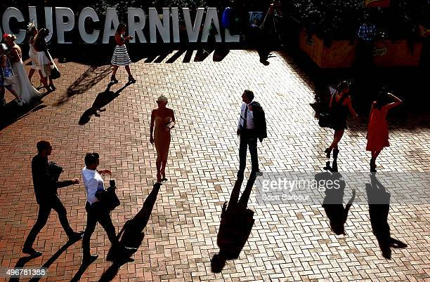 Racegoers make their way home after Oaks Day at Flemington Racecourse on November 5 2015 in Melbourne Australia