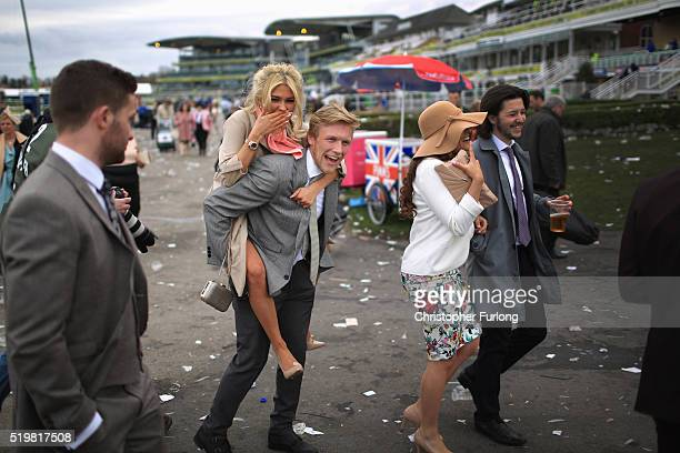 Racegoers make their way home at the end of Ladies Day the second day of the Aintree Grand National Festival meeting on April 8 2016 in Aintree...