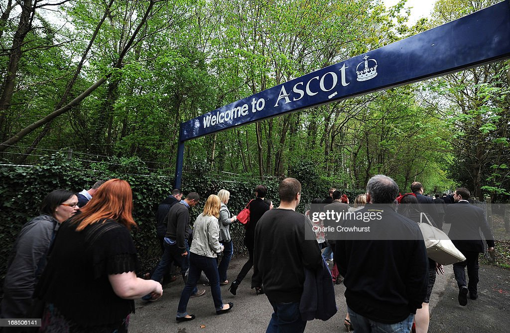 Racegoers make their way to the racecourse at Ascot racecourse on May 10, 2013 in Ascot, England.