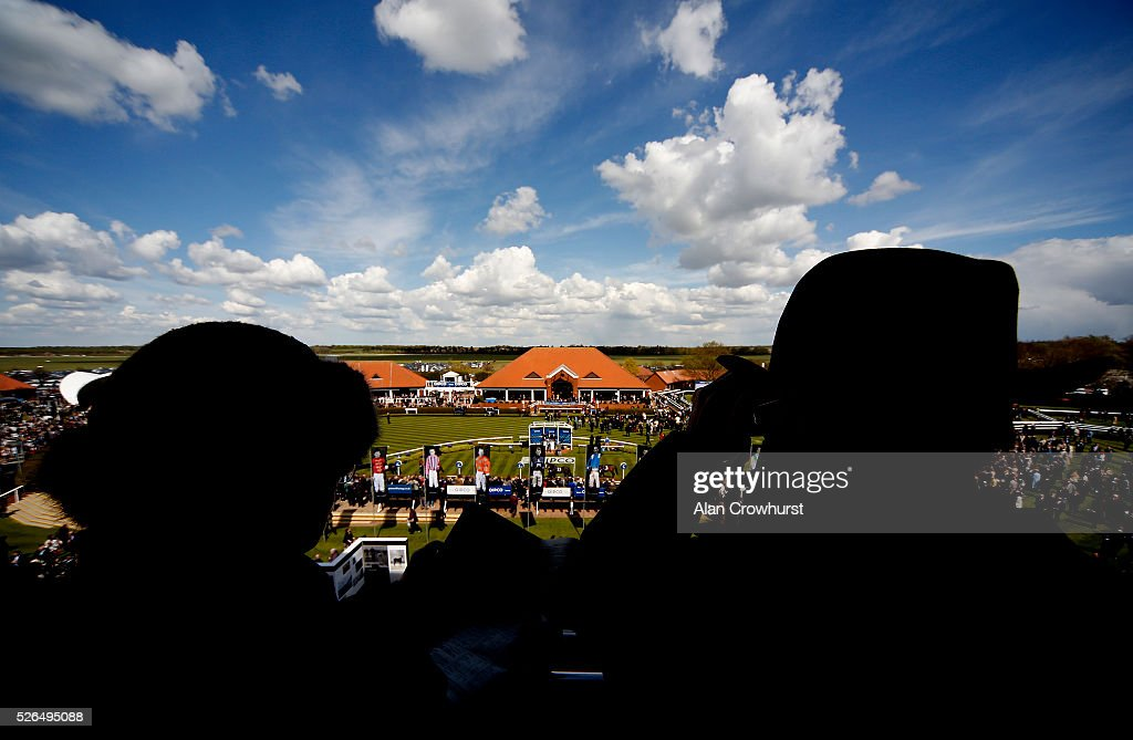 Racegoers overlook the parade ring before the first race at Newmarket racecourse on April 30, 2016 in Newmarket, England.