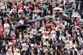 Racegoers pack the stands by the racecourse on Ladies Day at Royal Ascot on June 16 2011 in Ascot England The fiveday meeting is one of the...