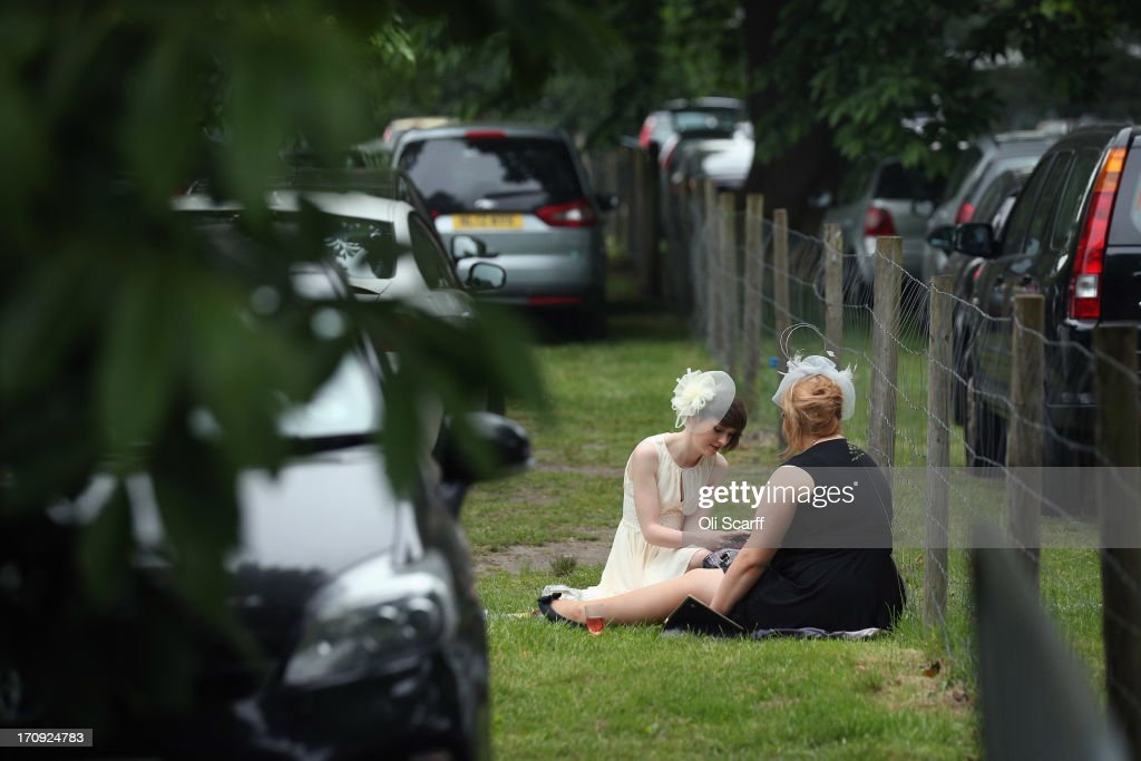 Racegoers picnic adjacent to Ascot racecourse before attending Royal Ascot on June 20, 2013 in Ascot, England. The 'Royal Ascot' horse race meeting runs from June 18, 2013 until June 22, 2013 and has taken place since 1711. The racecourse is expected to welcome around 280,000 racegoers over the five days, including Her Majesty The Queen and other members of the Royal Family.